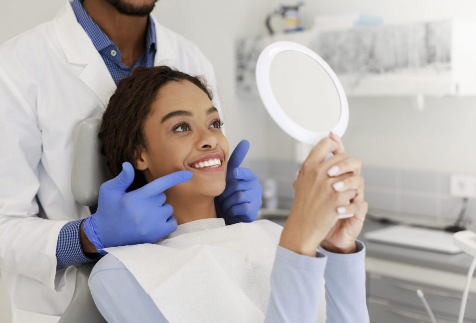 Lady check her dental implant