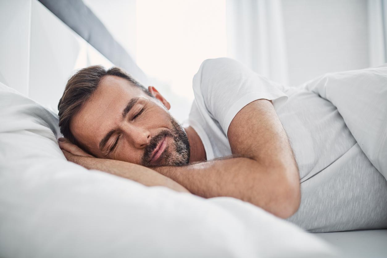 man sleeping using sleep apnea devices